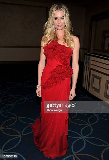 Actress Rebecca Romijn prepares backstage at The Heart Truth's Red Dress Collection 2012 Fashion Show at Hammerstein Ballroom on February 8 2012 in...