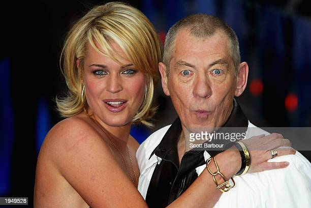 Actress Rebecca Romijn-Stamos and actor Sir Ian McKellen pose for photographers as they arrive at the world premiere of 'X-Men 2' April 24, 2003 in...
