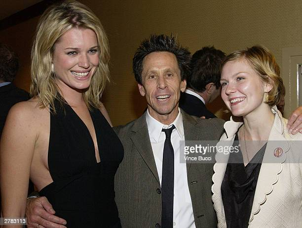 Actress Rebecca RomijnStamos producer Brian Grazer and actress Kirsten Dunst attend the first Annual Oceana Partners Awards Dinner December 3 2003 in...