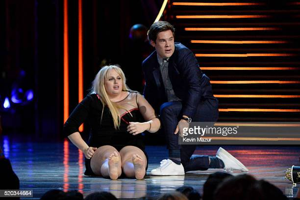 Actress Rebel Wilson and actor Adam DeVine accept the Best Kiss award for 'Pitch Perfect 2' onstage during the 2016 MTV Movie Awards at Warner Bros...