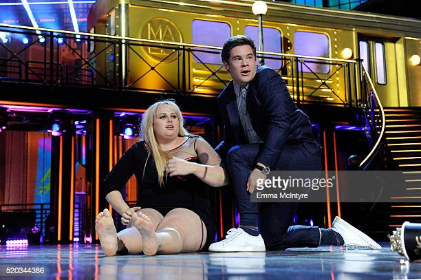 Actress Rebel Wilson and actor Adam DeVine kiss while accepting the Best Kiss award for 'Pitch Perfect 2' onstage during the 2016 MTV Movie Awards at...