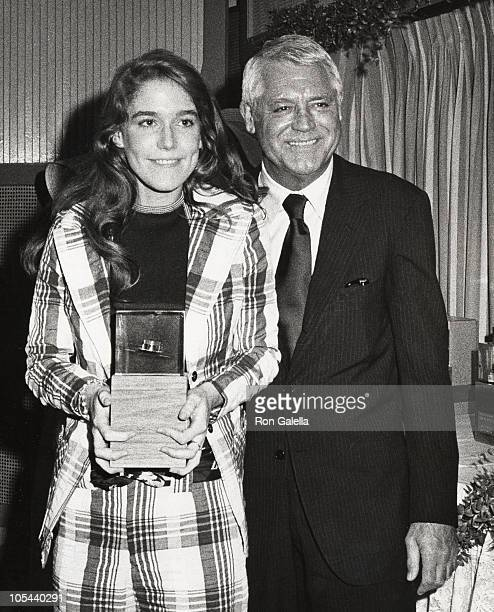 Actress receiving an award from Cary Grant during 3rd Annual Straw Hat Awards at Tavern on the Green in New York City, New York, United States.