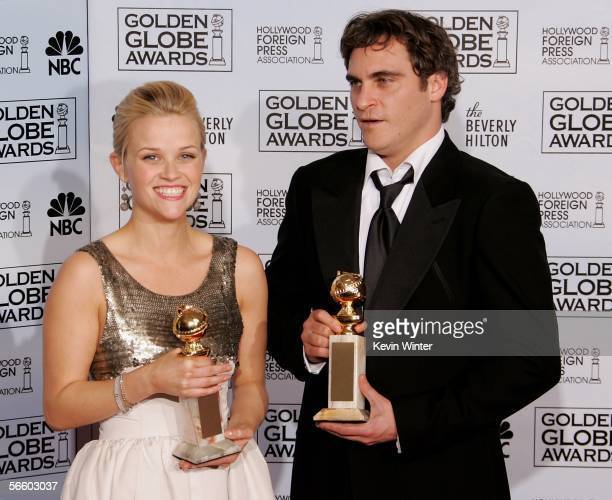 Actress Reese Witherspoon and actor Joaquin Phoenix with their awards for Best Actress and Best Actor Musical or Comedy for Walk The Line pose...