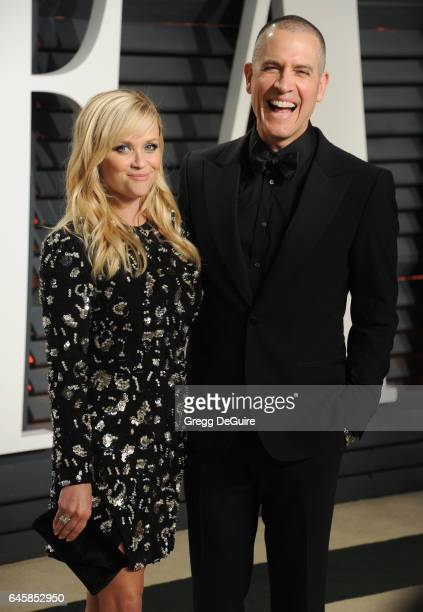 Actress Reese Witherspoon and husband Jim Toth arrive at the 2017 Vanity Fair Oscar Party Hosted By Graydon Carter at Wallis Annenberg Center for the...