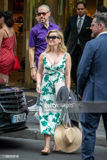Actress Reese Witherspoon and Jim Toth are seen on June 30, 2019 in Paris, France.