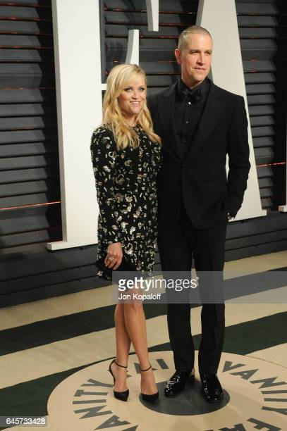 Actress Reese Witherspoon and Jim Toth attend the 2017 Vanity Fair Oscar Party hosted by Graydon Carter at Wallis Annenberg Center for the Performing...