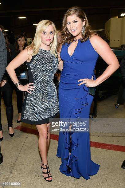 Actress Reese Witherspoon and recording artist Hillary Scott of music group Lady Antebellum pose backstage at the 50th Academy of Country Music...
