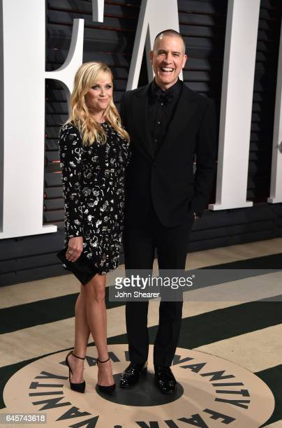 Actress Reese Witherspoon and talent agent Jim Toth attend the 2017 Vanity Fair Oscar Party hosted by Graydon Carter at Wallis Annenberg Center for...