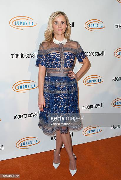 Actress Reese Witherspoon arrives at the 12th Annual Lupus LA Hollywood Bag Ladies Luncheon at The Beverly Hilton Hotel on November 21 2014 in...