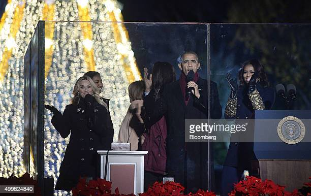 Actress Reese Witherspoon from left daughter Sasha Obama Marian Robinson Michelle Obamas mother daughter Malia Obama US President Barack Obama and...