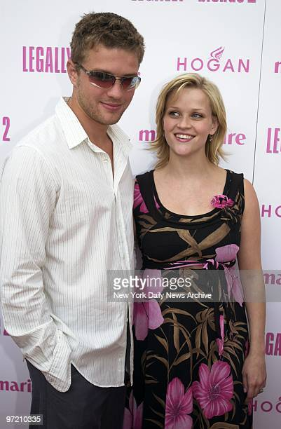 "Actress Reese Witherspoon is joined by her husband, Ryan Phillippe, at the opening of her movie, ""Legally Blonde 2: Red, White & Blonde,"" at the..."