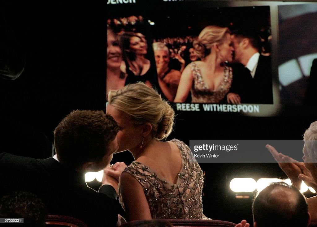 Actress Reese Witherspoon kisses Ryan Phillippe before she goes onstage to accept the Best Actress Award during the 78th Annual Academy Awards at the Kodak Theatre on March 5, 2006 in Hollywood, California.