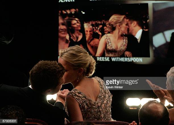 BROADCAST*** Actress Reese Witherspoon kisses Ryan Phillippe before she goes onstage to accept the Best Actress Award during the 78th Annual Academy...