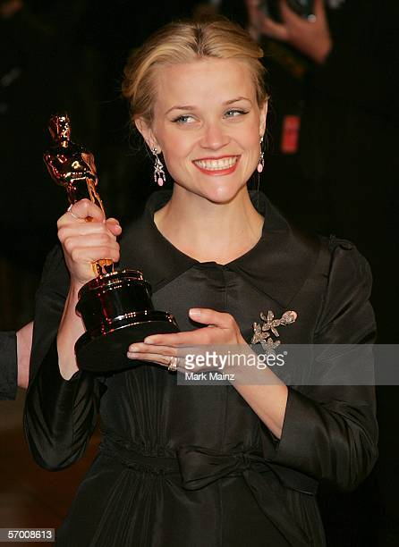 Actress Reese Witherspoon with her award for Best Actress in a Leading Role for Walk The Line arrives at the Vanity Fair Oscar Party at Mortons on...