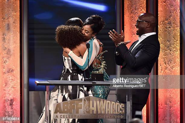 Actress Regina King accepts the ABFF Excellence in the Arts Award from actors Regina Hall and Taye Diggs onstage during the 2016 ABFF Awards A...