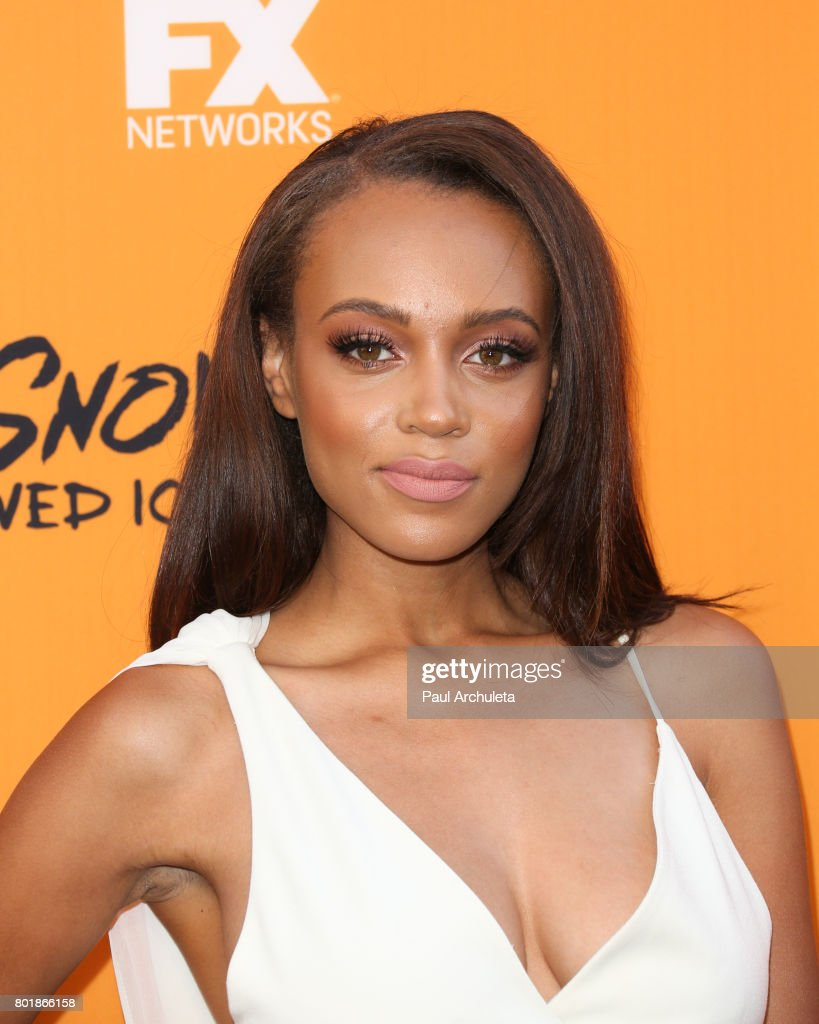 Actress Reign Edwards attends the premiere of FXs