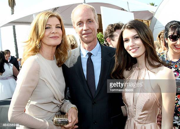 Actress Rene Russo writerdirector Dan Gilroy and Rose Gilroy pose outside the Heineken tent during the 30th Annual Film Independent Spirit Awards at...