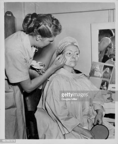 Actress Renee Asherson having makeup applied for her role as Queen Victoria during the filming of the television series 'Happy and Glorious' at Lime...