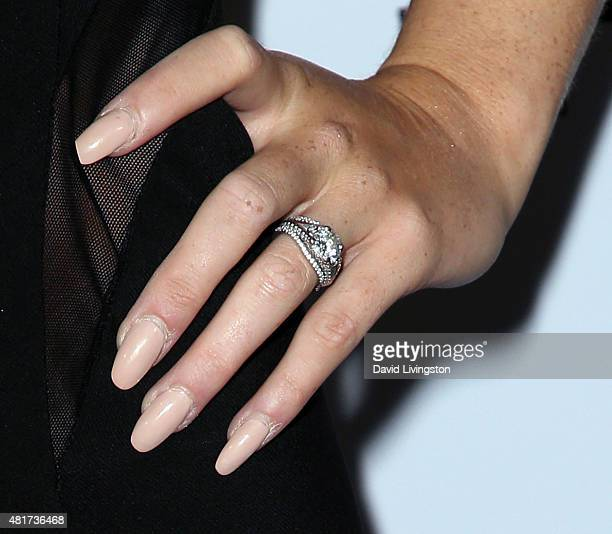 Actress Renee Olstead, ring detail, attends the Michael Costello and Style PR Capsule Collection launch party on July 23, 2015 in Los Angeles,...