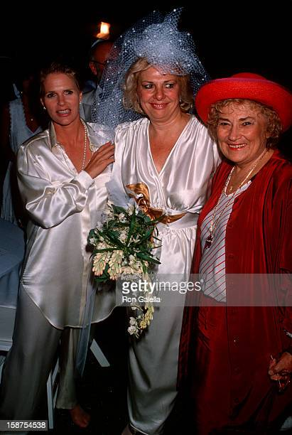 Actress Renee Taylor, Bella Abzug and guest attending 25th Wedding Anniversary for Renee Taylor and Joseph Bologna on August 19, 1990 in Beverly...