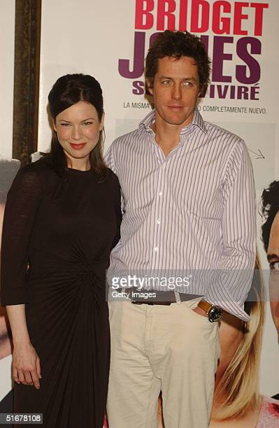 Actress Renee Zellweger and actor Hugh Grant pose at a photocall to promote film Bridget Jones The Edge Of Reason at Hotel Ritz on November 5 2004 in...