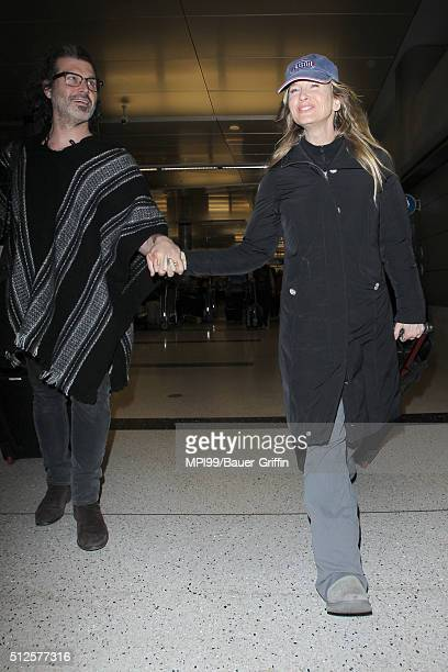 Actress Renee Zellweger and boyfriend Doyle Bramhall II arrive at LAX airport after flying in from London on February 26 2016 in Los Angeles...