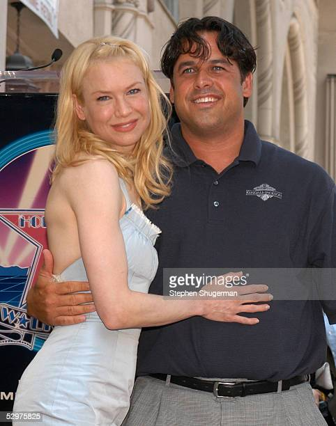 Actress Renee Zellweger and brother Drew Zellweger pose as she receives her star on the Hollywood Walk of Fame on Hollywood Blvd on May 24 2005 in...
