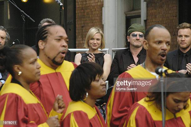 Actress Renee Zellweger and singer Bono watch a gospel choir perform at the Ceremony of Remembrance and Commemoration at the 2nd Annual Tribeca Film...