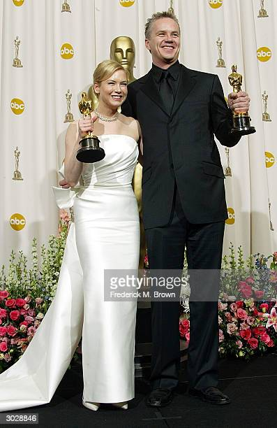 Actress Renee Zellweger and Tim Robbins pose with the Oscars for Best Supporting Actress and Actor during the 76th Annual Academy Awards at the Kodak...