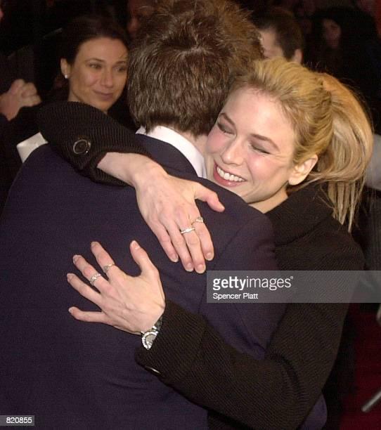 Actress Renee Zellweger hugs actor Hugh Grant at the premiere of Bridget Jones's Diary April 2 2001 in New York City