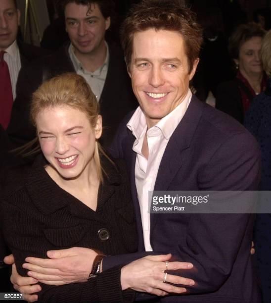 """Actress Renee Zellweger hugs actor Hugh Grant at the premiere of """"Bridget Jones's Diary"""" April 2, 2001 in New York City."""