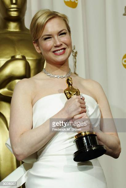 Actress Renee Zellweger poses with her Oscar for Best Supporting Actress during the 76th Annual Academy Awards at the Kodak Theater on February 29...