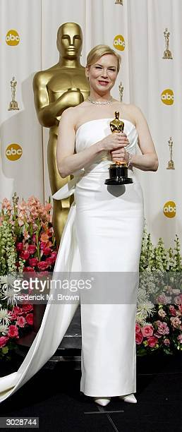 Actress Renee Zellweger poses with her Oscar for Best Supporting Actress during the 76th Annual Academy Awards at the Kodak Theater on February 29,...