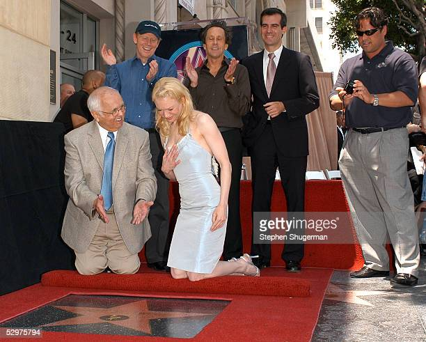 Actress Renee Zellweger poses with Hollywood Mayor Johnny Grant director Ron Howard producer Brian Grazer Councilman Eric Garcetti and brother Drew...