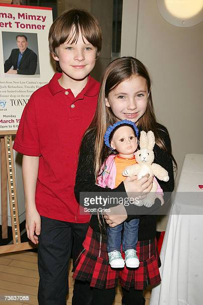 Actress Rhiannon Leigh Wryn and actor Chris O'Neil pose with the limited edition Emma and Mimzy dolls during a doll signing to celebrate the premiere...