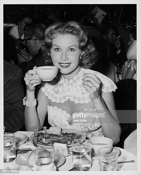 Actress Rhona Fleming sitting at her table at the Hairdressers and Makeup Annual Party at the Palladium circa 1960