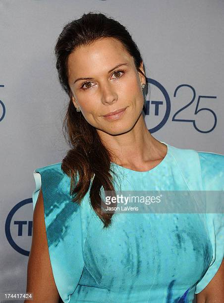 Actress Rhona Mitra attends TNT's 25th anniversary party at The Beverly Hilton Hotel on July 24 2013 in Beverly Hills California