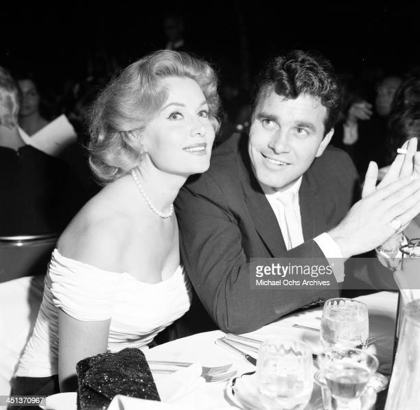 Actress Rhonda Fleming pose with Lang Jefferies at a party in Los Angeles California