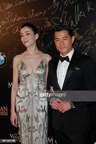 Actress Rie Miyazawa and actor Aaron Kwok walk the red carpet during the 9th Asian Film Awards on March 25 2015 in Macau China