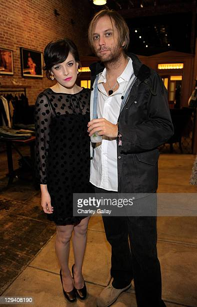 Actress Riley Keough and musician Matt Beckley attend The Mick Rock Exhibit hosted by Riley Keough and Shepard Fairey at Confederacy on December 16...