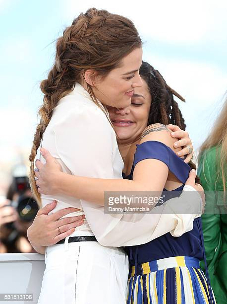 Actress Riley Keough and Sasha Lane embrace during the 'American Honey' photocall during the 69th annual Cannes Film Festival at the Palais des...