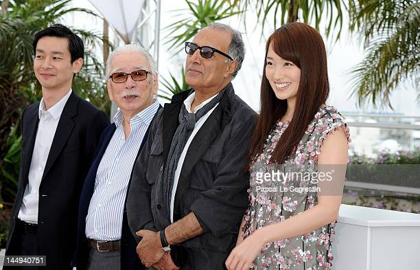 Actress Rin Takanashi director Abbas Kiarastami actors Tadashi Okuno and Ryo Kase poses at the Like Someone in Love photocall during the 65th Annual...