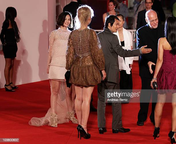 Actress Rinko Kikuchi actress Kiko Mizuhara and director Anh Hung Tran attend the 'Norwegian Wood' premiere during the 67th Venice Film Festival at...