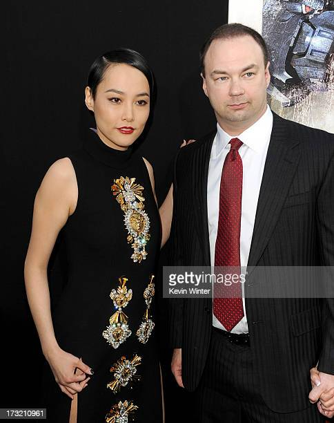 Actress Rinko Kikuchi and producer Thomas Tull arrive at the premiere of Warner Bros Pictures' and Legendary Pictures' Pacific Rim at Dolby Theatre...