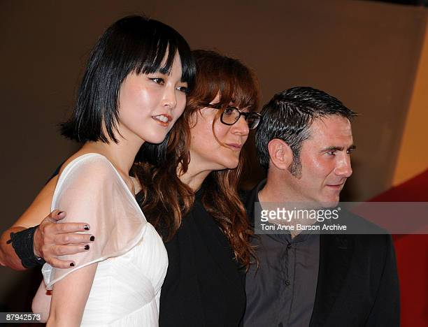 Actress Rinko Kikuchi director Isabelle Coixet and actor Sergi Lopez attend the Map of the Sounds of Tokyo Premiere at the Palais des Festivals...