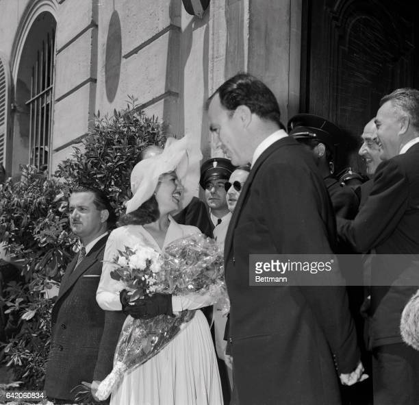 Actress Rita Hayworth and Prince Aly Khan leave Vallauris City Hall May 27 following their marriage by the town's mayor the couple then received...