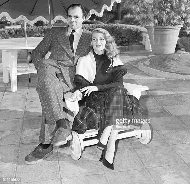 Actress Rita Hayworth and Prince Aly Khan who are to be married soon pose for photographers on the terrace of the Cannes France chateau of Aly's...