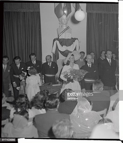 Actress Rita Hayworth smiles radiantly after her marriage to Prince Ali Khan at a simple ceremony in Vallauris Town Hall May 27 Between the Bridal...