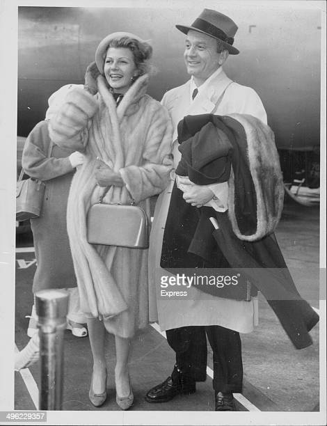 Actress Rita Hayworth with her husband James Hill arriving at London Airport wearing a mink coat London circa 19581961