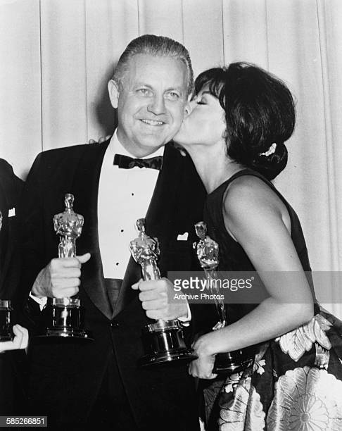 Actress Rita Moreno kissing the cheek of director Robert Wise both Oscar winners for their film 'West Side Story' at the 39th Academy Awards Los...